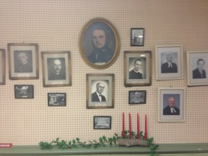 Pastoral commemorative wall. Portraits of the men and their graves.